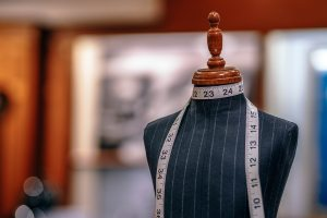 tailors dummy with tape measure